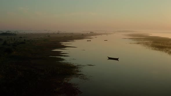 Thumbnail for Aerial Drone View, Drone Flies Forward Slowly Towards, Boat on the Sunrise, Morning Fishing
