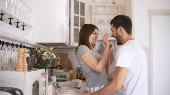 Cover Image for Playful Couple in Kitchen