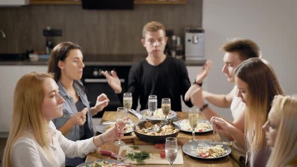 Thumbnail for Happy Young People at Table in Kitchen