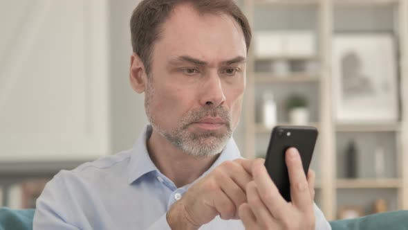 Thumbnail for Senior Aged Businessman Using Smartphone, Typing Message