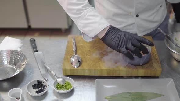 Thumbnail for Chef in Black Rubber Gloves Finishing To Prepare Dish with Raw Tuna and Salmon in Modern Restaurant