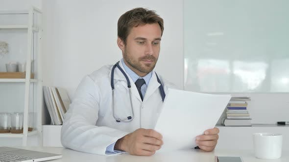 Thumbnail for Doctor Reading Documents in Clinic, Paperwork