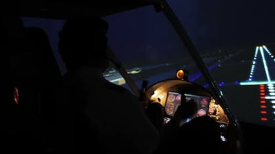 Professional Pilot Landing Airplane on the Runway, Evening Time, Aviation