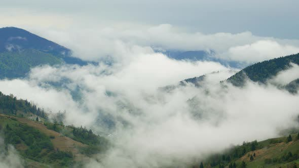 Fog and clouds over the mountains, morning in the mountains, Ukrainian Carpathians