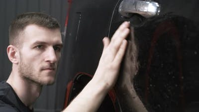 Man Hand Washing Car