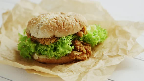Thumbnail for Chicken Burger Lying on Parchment