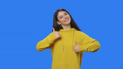 Portrait of Pretty Brunette Showing Thumbs Up Gesture Like