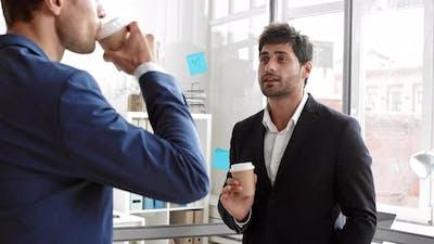 Coworkers Gossiping on Coffee Break