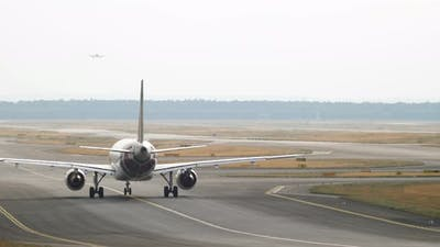 Airplane on the Runway Is Taxiing