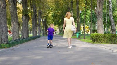 Mom and Son on Walk in Park