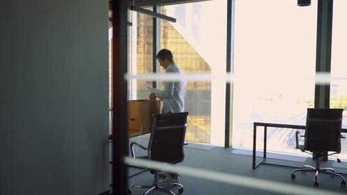 Man in Office Bring His Box and Belongings