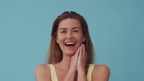 Stunning Lady in Yellow Sleeveless Top Bursting into Laughter