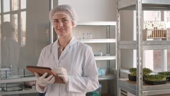 Thumbnail for Portrait of Female Biologist Holding Digital Tablet