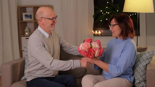 Thumbnail for Happy Senior Couple with Bunch of Flowers at Home