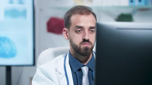 Thumbnail for Close Up Shot of Tired and Exhausted Doctor Working on the Computer