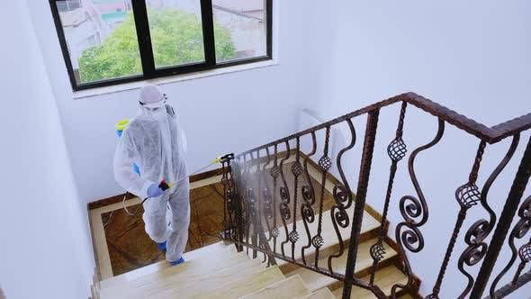 Man in Biohazard Costume Sprays Chemical