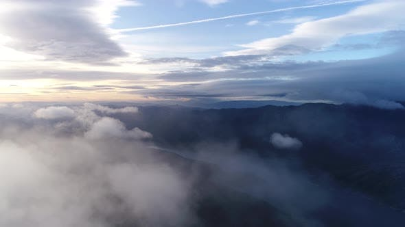 Thumbnail for Surreal View Flying through Clouds at Sunset