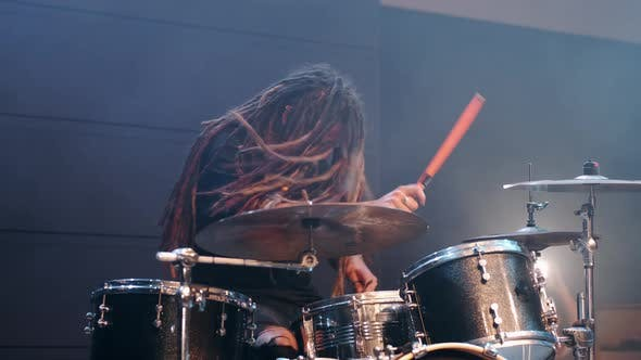 Thumbnail for Talented Musician with Dreadlocks Play on Drums in Smoke in a Club