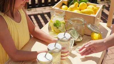 Buying Lemonade At Stand Outdoors