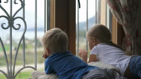 Stay at Home Quarantine Coronavirus Pandemic Prevention, Brother and Sister Looking Out the Window