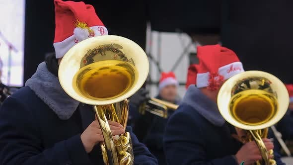 Thumbnail for Brass Orchestra in Funny Hats Playing Christmas Carols Creating Holiday Spirit