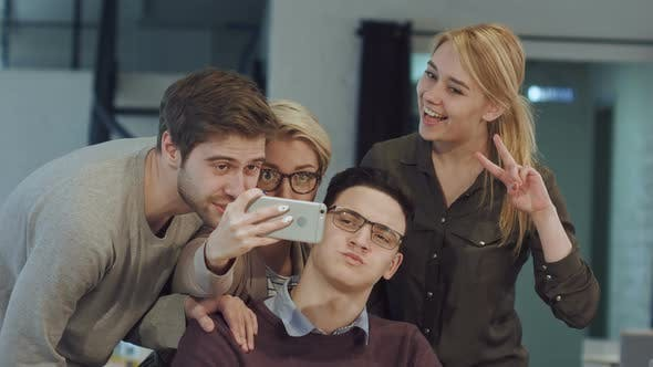 Thumbnail for Smiling Business People Taking Selfie in Meeting Room at Creative Office