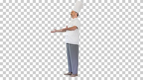 Thumbnail for Smiling chef welcomes guests to his restaurant, Alpha Channel