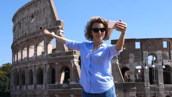 Thumbnail for Young Woman Taking Selfie Using Smartphone At Famous Tourist Attraction