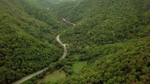 Thumbnail for Aerial View Of Countryside Road Passing Through The Mountain Landscape 09