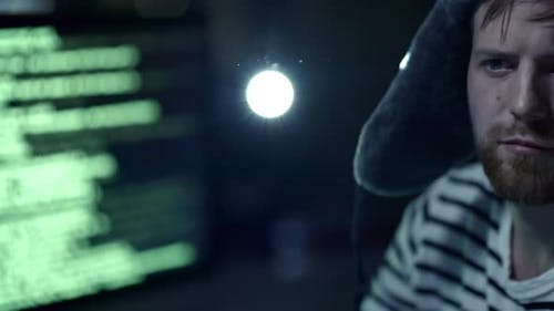 Russian Cybercriminal Attacking System at Night