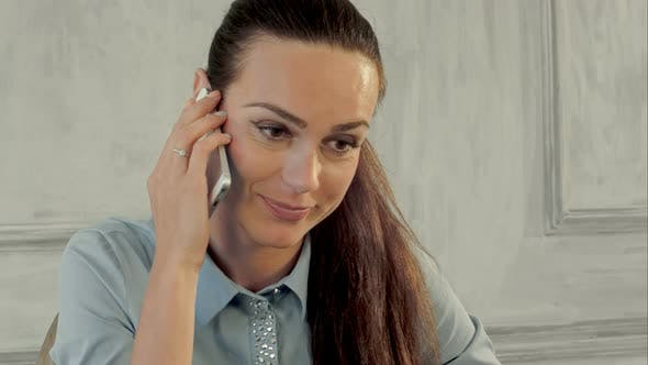 Thumbnail for Businesswoman Receiving Bad News By Cell Phone