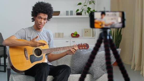 Male Vlog Teather Afro Artist Performancing Music Show Teaching How To Play Guitar Online Streaming