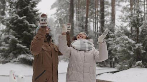 People Rejoicing at Snowfall