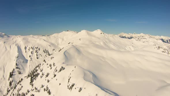 Flying Over Untouched Glacial Snowfield With Helicopter North Cascades Mt Baker Backcountry Sunny