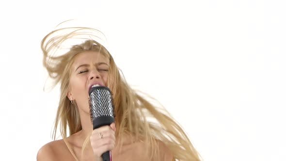 Thumbnail for Sexy Girl Singing and Dance Using a Brush As a Microphone, Slow Motion, Close Up, Bathroom