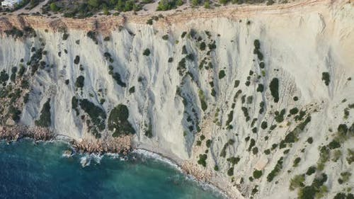 Edge of Mountain Cliff and Ibiza Ocean Waters