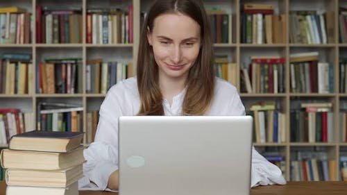 Woman Using Laptop and Learning Online