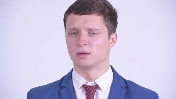 Thumbnail for Face of Serious Young Businessman Nodding Head No