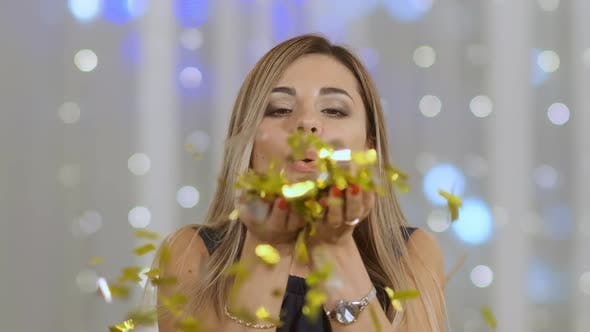 Thumbnail for Beautiful Woman Blowing on Confetti