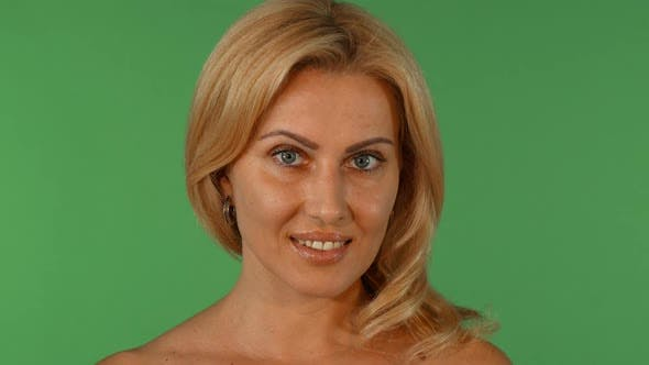 Thumbnail for Gorgeous Sexy Mature Blond Haired Woman Smiling Seductively To the Camera 1080p
