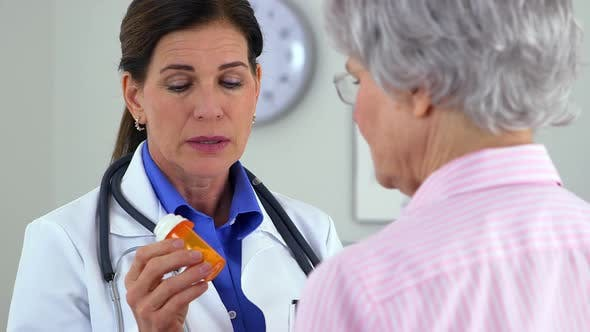 Thumbnail for Senior doctor talking positively about medication to patient