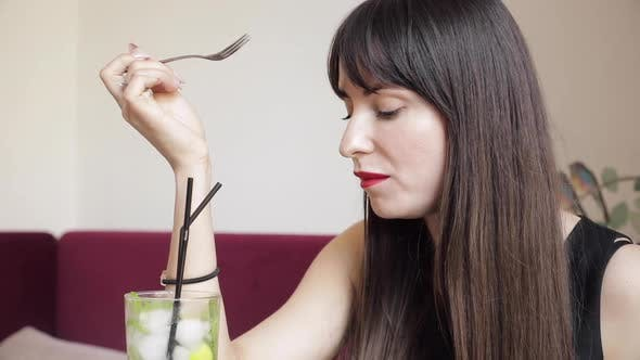 Thumbnail for Side View of Young Brunette Eating Delicious Cake in Cafe