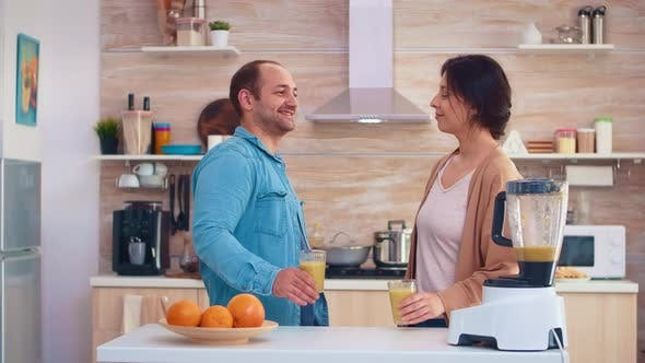Couple Holding Nutritious Smoothie