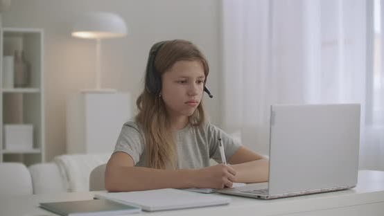 Thumbnail for Online Lesson for Schoolgirl, Pupil Is Staying Home, Using Laptop and Headphone for Communicating