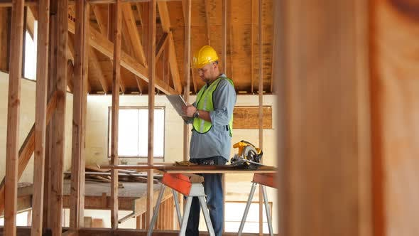 Thumbnail for Construction worker using digital tablet on work site