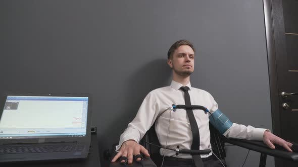 Thumbnail for Handsome Man Wearing Wire Indicators During Polygraph Test