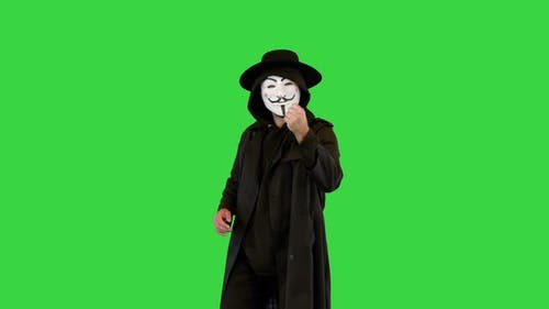 Anonymous Wearing Anonym Mask Calling you to Join Him on a Green Screen Chroma Key