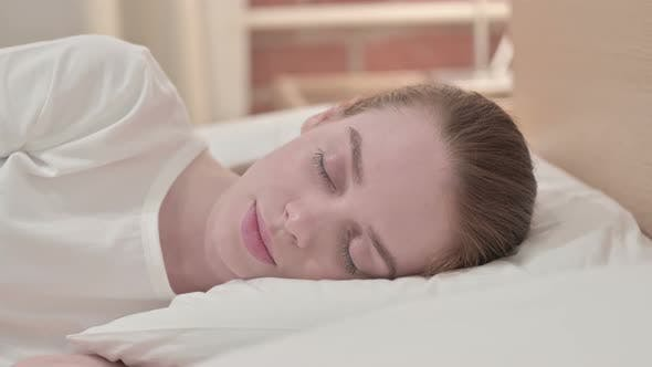 Thumbnail for Peaceful Redhead Young Woman Sleeping in Bed