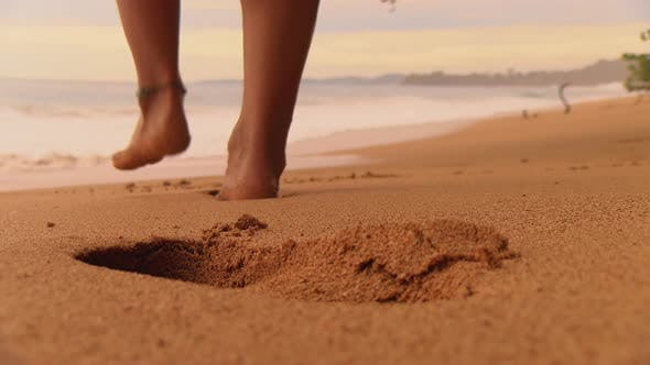 Thumbnail for Boy with Bare Feet Leaving his Footprints on the Sand of a Tropical Beach