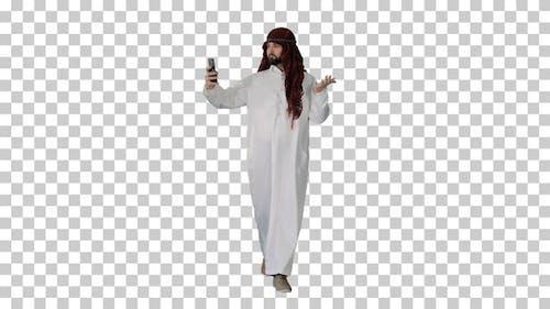 Arabian man walking and making a selfie, Alpha Channel